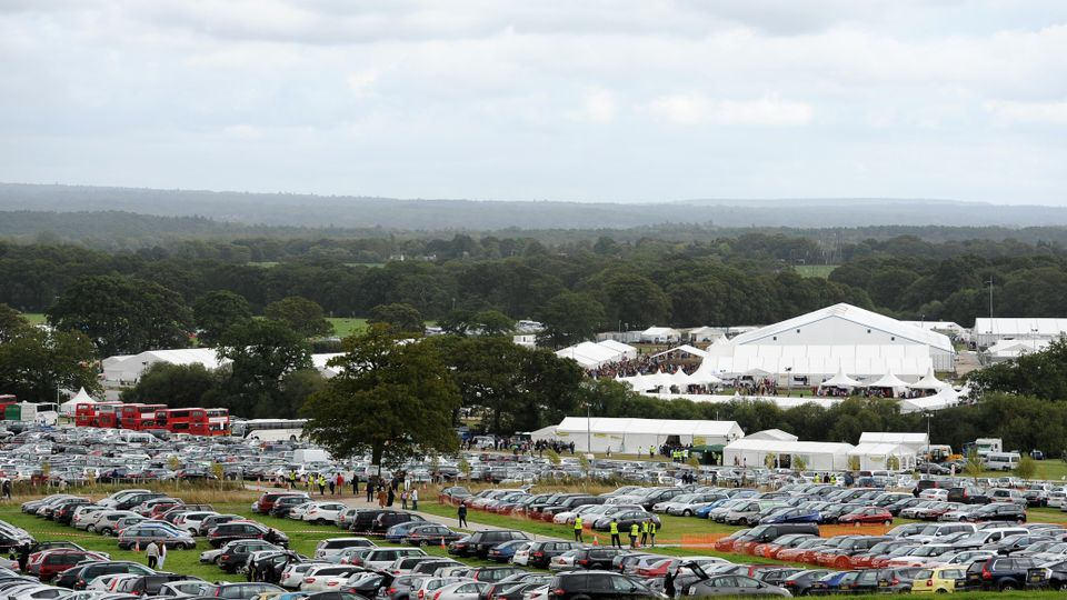 Jalsa Salana annual muslim convention in Alton, Hampshire - field with marquees and parked cars